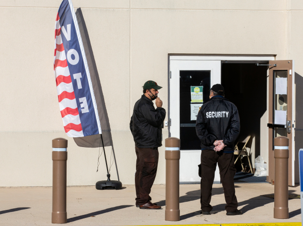 Hired security personnel wait for voters outside the Leon County Supervisor of Elections office on November 3, 2020 in Tallahassee, Florida.